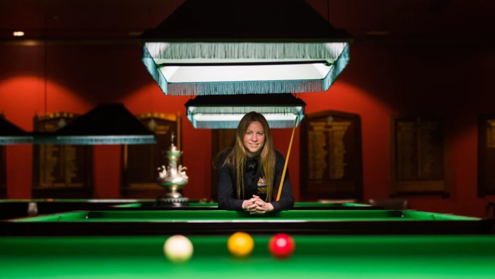 Anna Lynch standing at the pool table