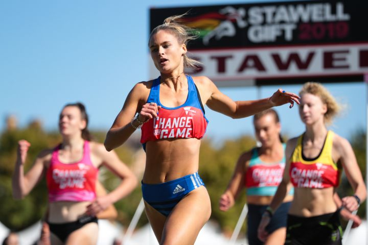 Woman crossing the finish line at the Stawell Gift