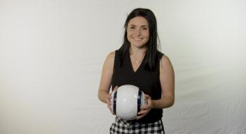Ambassador Tal Karp poses with soccer ball