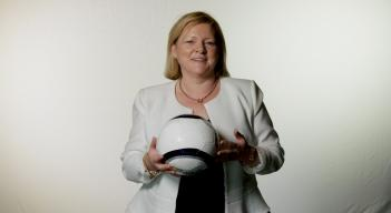 Ambassador Stella Smith poses with a soccer ball