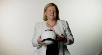 Ambassador Stella Smith poses with a soccer ball